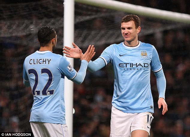Back in the action: Edin Dzeko rounded off the rout to further consign West Ham's misery