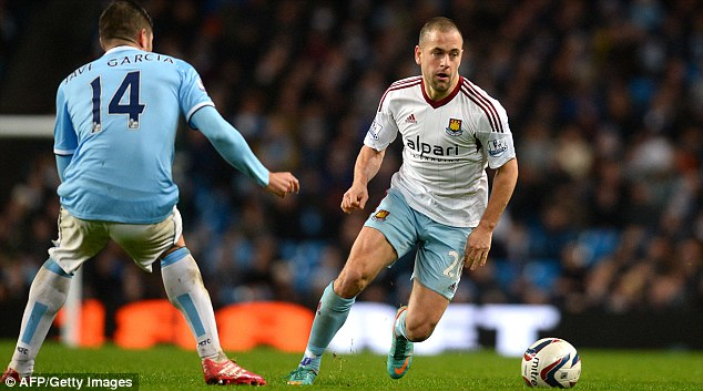 Rare possession: West Ham's Joe Cole (right) takes the ball past City midfielder Javi Garcia