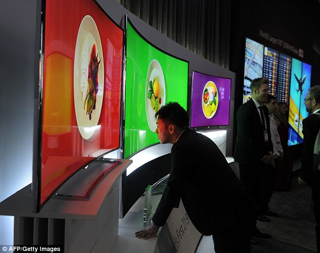 Up close and personal: A study released Thursday reveled that 70 percent of Americans suffer from digital eye strain caused by looking at electronic device screens for two or more hours. The study was presented by the Vision Council at the Consumer Electronics Show 2014 Ipictured) in Las Vegas