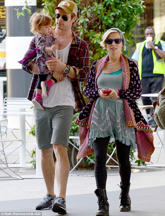 Brightening up LA: Chris Hemsorth held onto his daughter India Rose alongside his pregnant wife Elsa Pataky as they dined out in Santa Monica