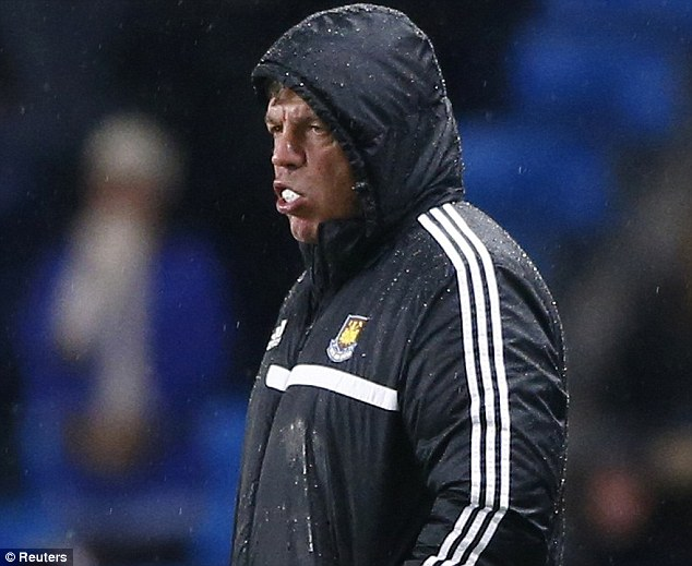 Looking glum, chewing gum: Allardyce looks like a beaten man on the sidelines at the Etihad