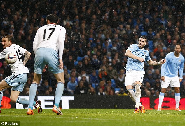 Hat-trick hero: Negredo curls the ball home to complete his treble