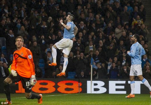Jumping for joy: Alvaro Negredo scored a hat-trick for Man City against West Ham on Wednesday night