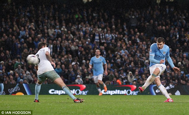 Sliced open: Dzeko finds the top corner after some stunning interplay on the left wing for City's sixth