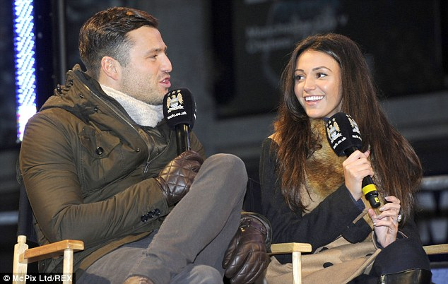 Pitch battle: Actress Michelle Keegan (right), a City fan, with fiance Mark Wright from TOWIE, a Hammer