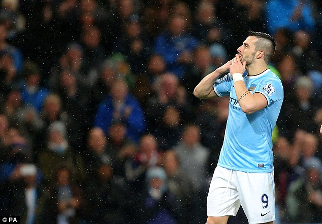 Beauty from the beast: Negredo blows a kiss to City supporters during the 6-0 rout of West Ham