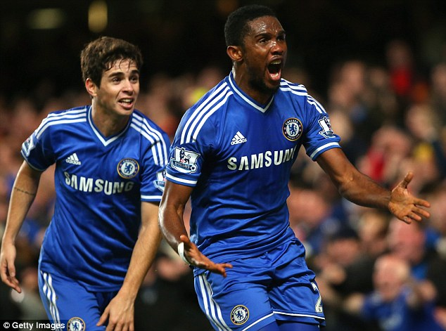 Cashing in: Samuel Eto'o (right), celebrating with Chelsea team-mate Oscar, is second
