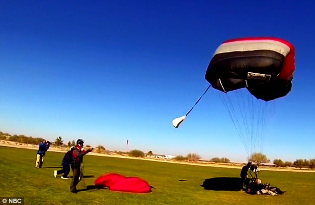 Ms Giffords lands safely after jumping from a plane thousands of feet in the air on January 8, 2011