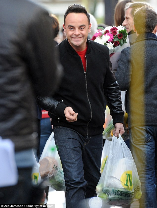 Pleased as punch: It appeared as though Ant had snapped up a bargain in the advert as he left with a number of bags
