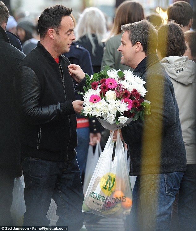Listen up: Ant opted for a black bomber jacket while Dec sported a grey wool coat