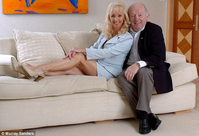 Magician Paul Daniels and wife Debbie McGee at their home in Wargrave which has been flooded
