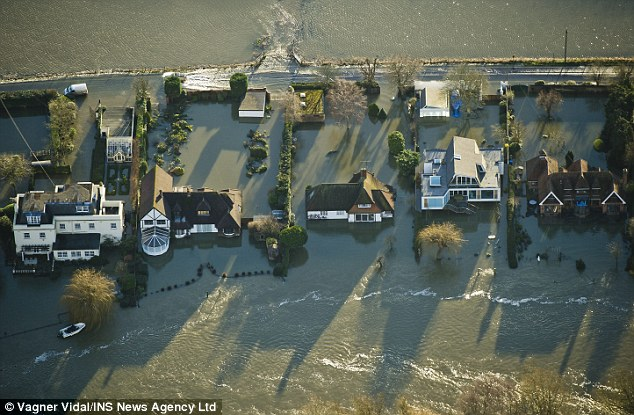 Evacuate: The River Thames burst its banks flooding homes in Marlow, Buckinghamshire