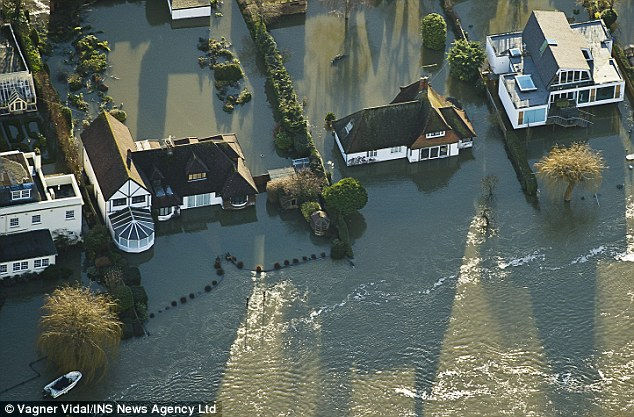 Homes in Marlow, Buckinghamshire, flooded today when the banks of the River Thames burst