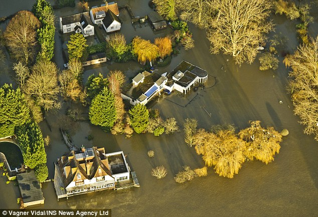 Gallons of floodwater cascaded into the TV funnyman's home which he shares with his partner