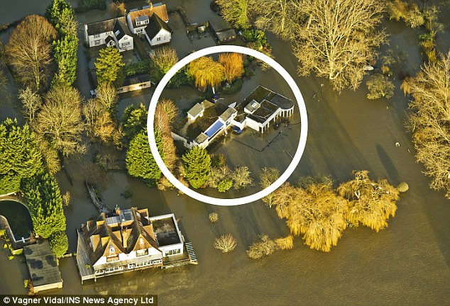 Celebrity Paul Daniels' home (circled) was flooded this week after the River Thames burst its banks