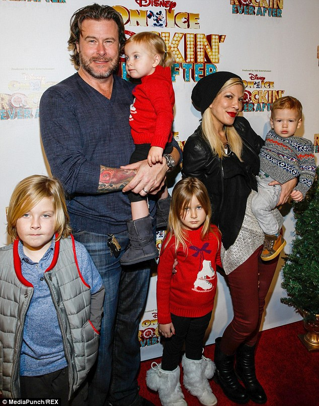Before the storm: The couple with their four children on December 12, just days before it was reported the actor had stepped out on his wife