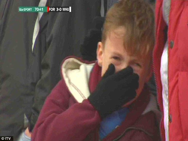 Fed up: One young supporter was captured by ITV cameras in floods of tears at the City Ground