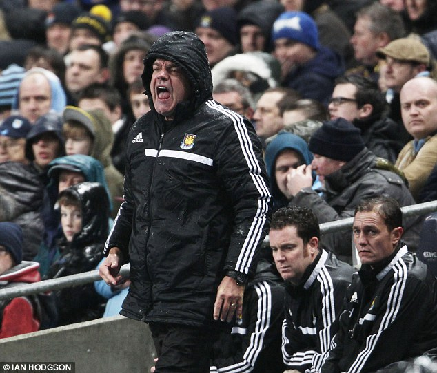 In vain: Allardyce bellows at his players from the bench during the thrashing on Wednesday evening