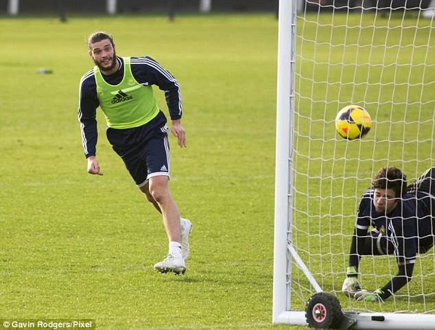 Hope? West Ham's record signing Andy Carroll is nearing fitness again, pictured in training on Thursday