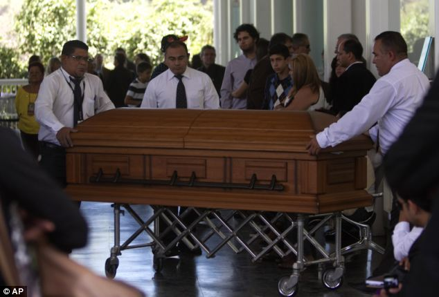 Mourning: The couple will be laid to rest side by side because family say 'that's how they lived their lives'
