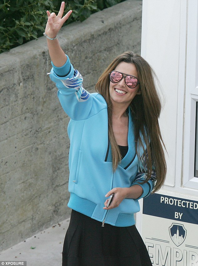 Peace out! Cheryl's chewing gum nearly fell out of her mouth because she was smiling so wide