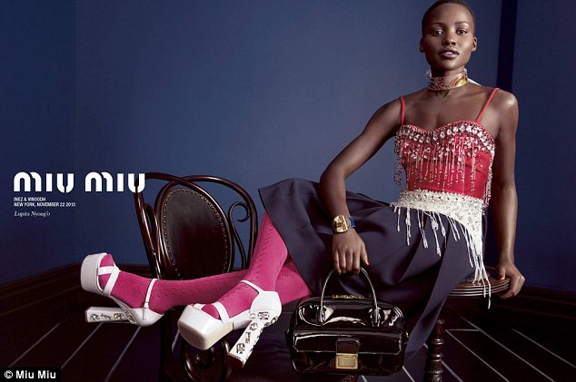 High fashion: Lupita currently fronts Miu Miu's spring 2014 campaign alongside ingénues Elle Fanning, Elizabeth Olsen, and Bella Heathcote