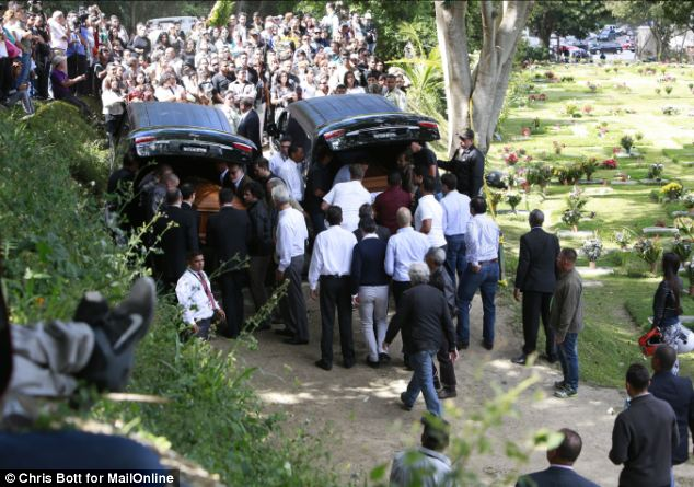 Popular: Hundreds of people turned out for the funeral of the couple. Their savage murders have caused shockwaves through Venezuela and have sparked a fresh wave of protest over the rate of murder there