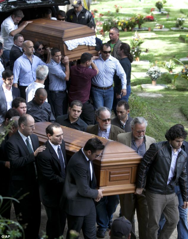 Together in death: Family members decided to bury them side-by-side even though they were separated in marriage. They believe the couple were about to be reconciled and that was the reason for their holiday together