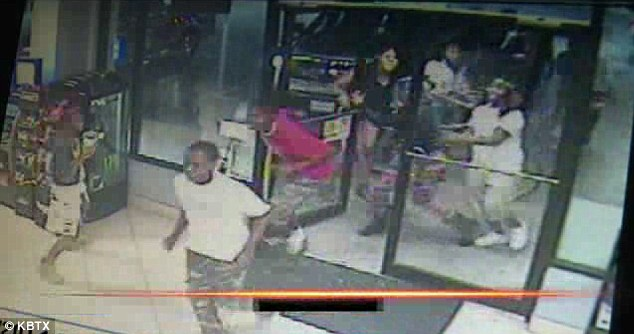 Caught: A mob of teenagers have been caught on tape robbing a convenience store in Bryan, Texas