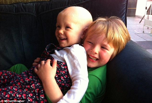 Loved: Lizzy (with brother George). In June, the month before her second birthday, doctors gave Lizzy a further dose of chemotherapy. this time she lost her eyelashes and eyebrows