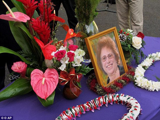 Tragic: A memorial for Loretta Fuddy, the director of the state Department of Health, is displayed outside the department in Honolulu