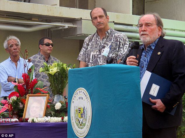 Sad: Hawaii Gov. Neil Abercrombie, right, speaks at a gathering in memory of Loretta Fuddy