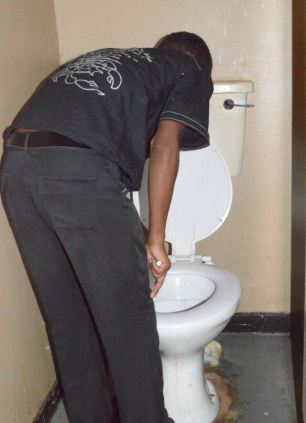 Photos that follow show dozens of people getting sick in the toilets - an image of the bathrooms show women clutching their stomach, while the men are vomiting in the sink.