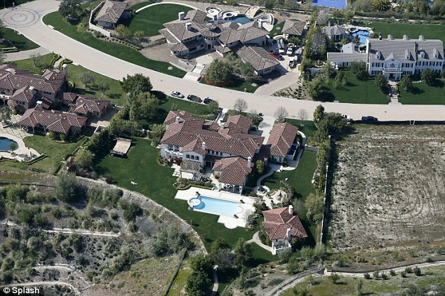 Sprawling estate: An aerial view of Bieber's home, centre, and the surrounding properties in Calabasas, California