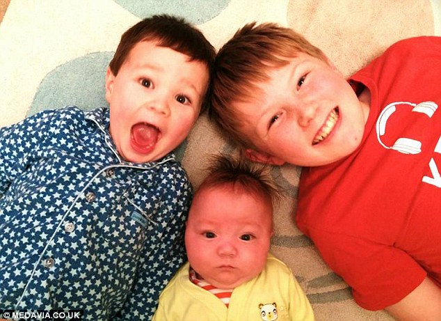 Brothers: Saxon (middle) with his older brothers Elliot, 11 (right) and Dexter, 4 (left), eight months after his incredibly premature birth