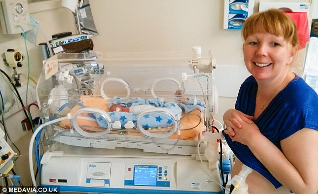 Happy mum: photos range from candid snaps to more posed photographs, and show the entirety of Saxon's early life as he grows stronger in the hospital