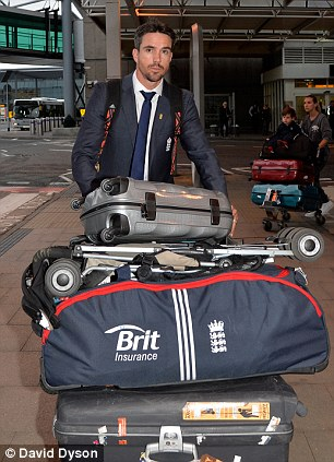 Back home: Kevin Pietersen arrives at Heathrow Airport from Australia after the disastrous Ashes tour