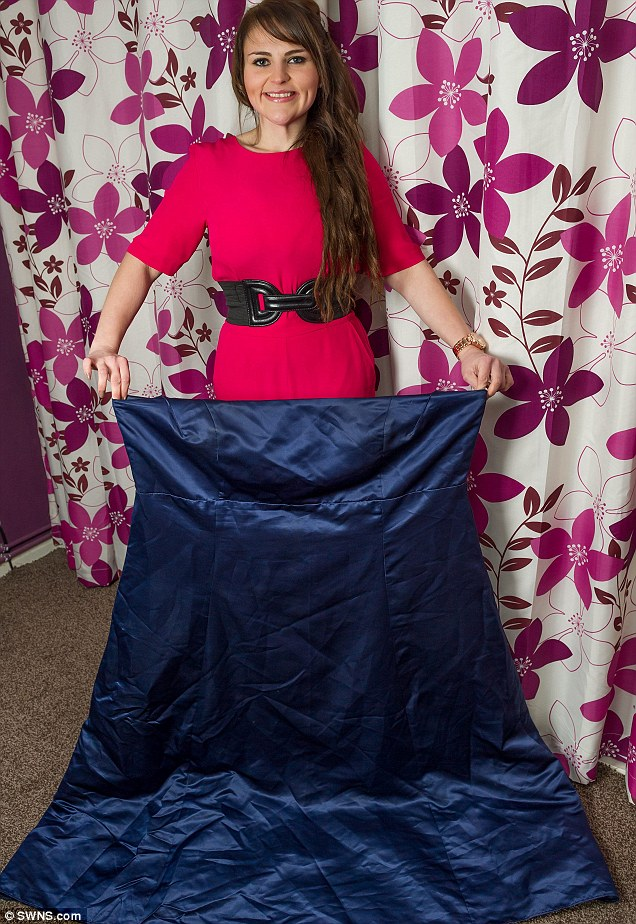 Stacey, pictured here with her old dress, has lost an incredible 12 stone and now is a size 10, weighing in at just 10st 8lb