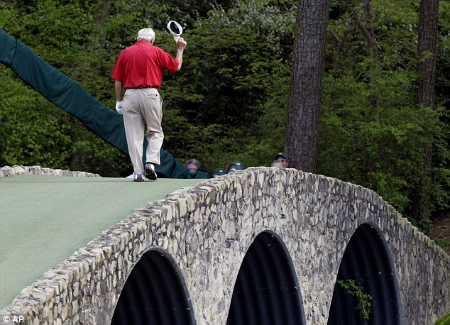 Farewell: Palmer walks across the Hogan Bridge at Augusta during  The Masters for the last time in 2004