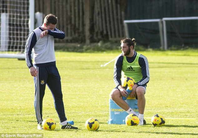 Breather: Carroll (right) may be rushed back from injury for the vital match against Cardiff