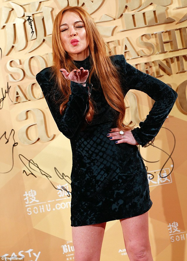 Is love in the air? Lindsay Lohan reportedly hooked up with a British model who studies at Liverpool John Moores University at the Shanghai Fashion Awards