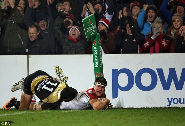 Breakthrough: Robbie Diack drags Montpellier's Lucas Dupont to score Ulster's first try at Ravenhill