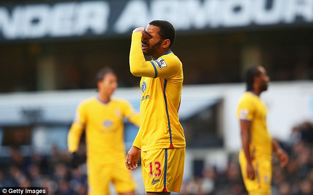 Agony: Puncheon reacts after missing the penalty, which didn't even test Spurs goalkeeper Hugo Lloris