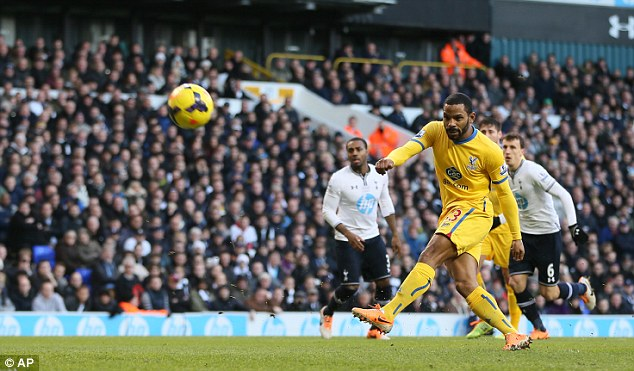 Wayward: Puncheon blasts his penalty high and wide of the goal in the first-half at White Hart Lane