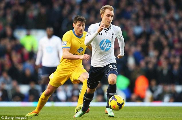 Shield the ball:  Christian Eriksen of Tottenham Hotspur is closed down by Joel Ward