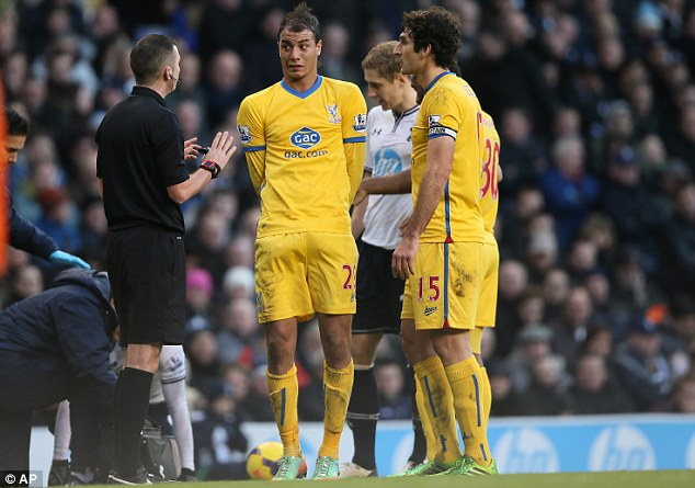 Ticking off: Referee Michael Oliver (left) talks to Marouane Chamakh after a collision with Kyle Walker