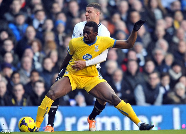 Tussle: Tottenham's Kyle Walker (left) and Crystal Palace's Yannick Bolasie challenge for the ball