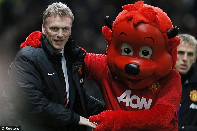 Under pressure: United manager David Moyes walks out with mascot Fred the Red at Old Trafford