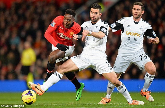 Challenge: Swansea's Jordi Amat fouls Danny Welbeck on the edge of the box in the first-half