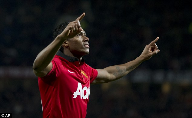 Ahead: Valencia celebrates after putting United 1-0 up just after the break at Old Trafford